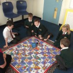 Counting up to 100 using our snakes and ladders game.