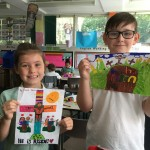 Chloe and Matthew show their winning entries in the Easter Art Competition.