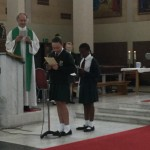 Emily and Angel read a Litany Prayer at the Pastoral Area School mass.